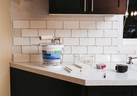 install tile backsplash kitchen how we installed our subway tile backsplash stager