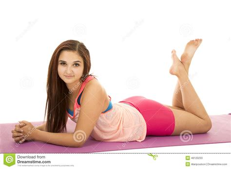 young teen legs spread laying down woman fitness pink lay on stomach legs up stock photo
