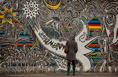 popular artwork tourists examine graffiti on berlin wall the golden scope