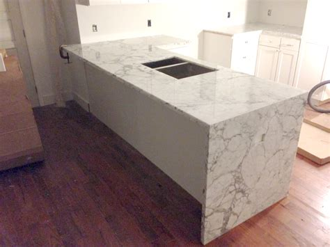 Pictures Of Backsplashes In Kitchens by Waterfall Counter Artistic Stone Kitchen And