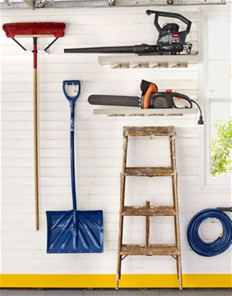 Garage Storage Brooms Power Tools Shovel And Tools On