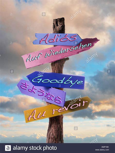 Auf Wiedersehen by Sign Notice Or Bill Board Saying Goodbye Au Revoir Adios