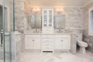 Flush inset cabinetry double vanity in marble master bath