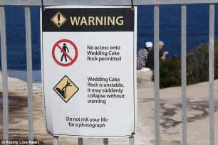 Wedding Cake Rock Fence by Visitors Ignore Signs And Pose For Photos On Notorious And