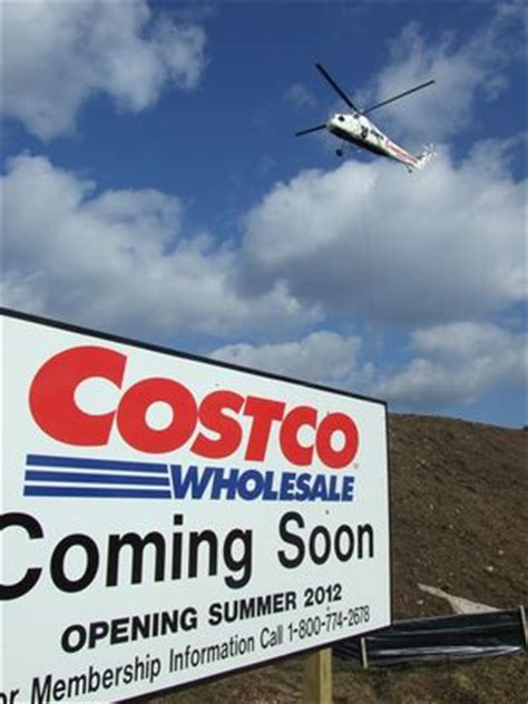 costco hvac helicopter hoists hvac units onto costco roof in