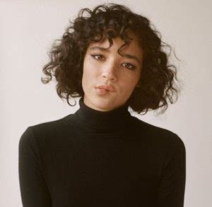 deep triangle bangs best short curly hairstyles you ll fall in love with