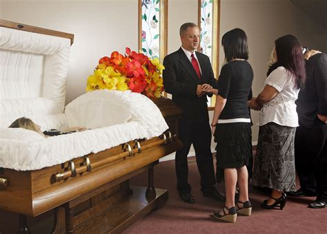 dead man in recliner at funeral home wake vs visitation what s the difference
