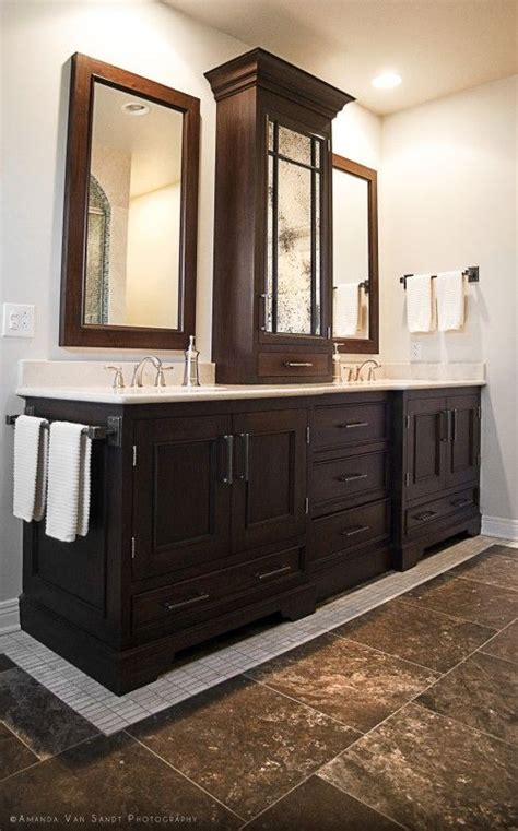 sink vanity with middle tower vanity with storage tower cabinet in the middle and