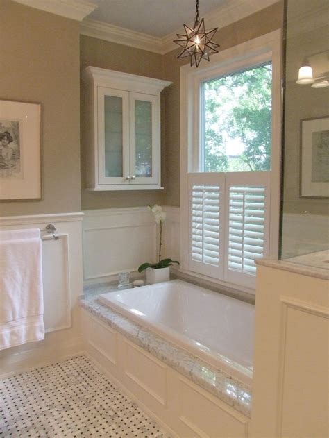 window in bathroom i like the panelling the coving and the marble top on the