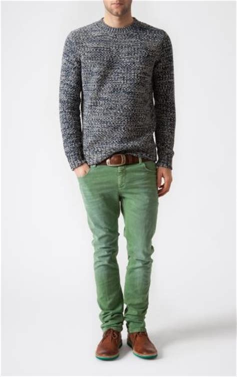 green and grey sweater on