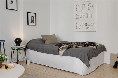 bed in the living room bed living room with dark touches coco lapine