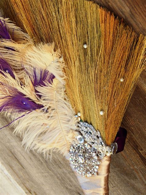 Ostrich and purple peacock feather wedding jumping broom