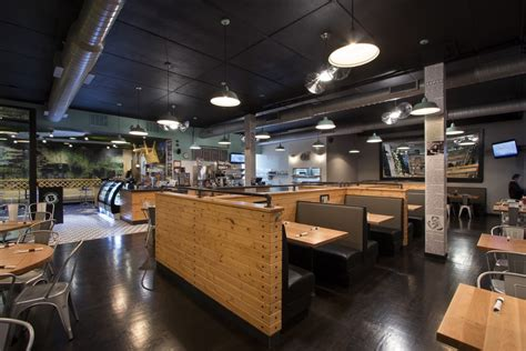 industrial ceiling industrial lighting lends chic atmosphere to restaurant