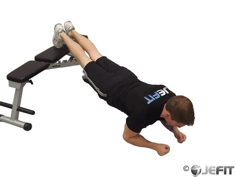 exercises using a bench plank with feet on bench exercise database jefit