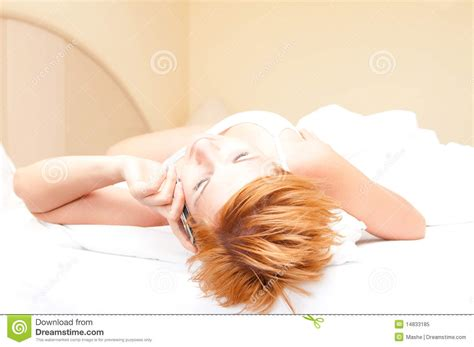 laying on bed woman laying on bed talking on cordless telephone royalty