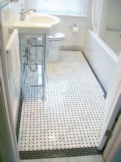 bathroom reno  basketweave floor tile  black border