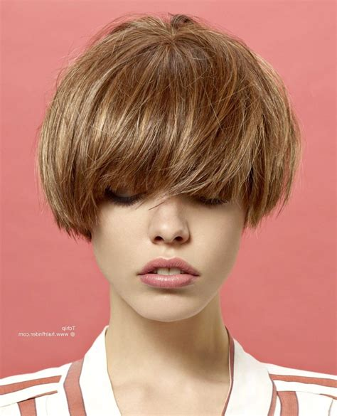 short bob behind ears with bangs over the ear bob haircuts for women