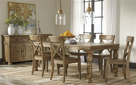 ashley trishley rect dining room 9 piece set furniture trishley brown extendable rectangular dining room set from