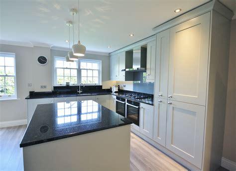 Shaker Kitchen With Granite Worktops by Partridge Grey Units With Black Granite Worktops Up