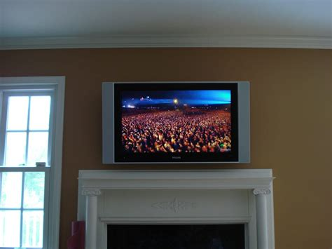 flat panel tv over fireplace with hidden components yelp