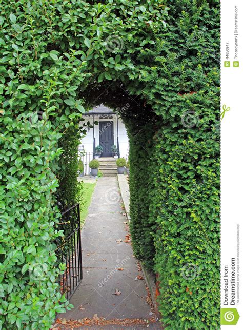 Victorian Mansion House Plans hedge keyhole arch pathway gate stock photo image 44650847