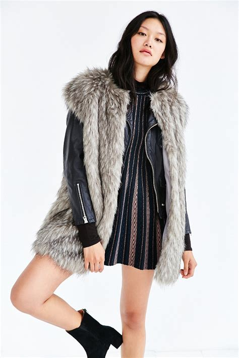Top With Faux Fur Detail On The Sleeves members only cap sleeve faux fur vest in gray lyst
