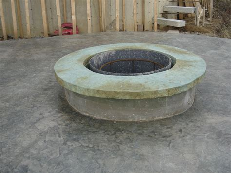 hometalk concrete pit with vertical carved stonework