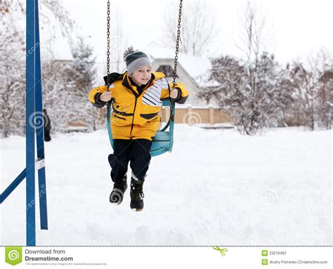 winter swing child on a swing in the winter stock photos image 23218463