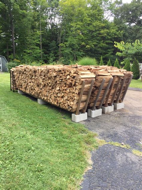 diy firewood rack cinder blocks firewood stacking racks holds 1 cord per row made with 3 cinder blocks 4 8ft 2x4 and 2 8ft