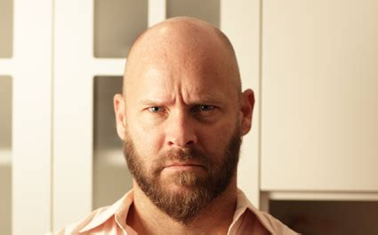 should men shave their heads bald man with shaved head and beard is going bald on his terms
