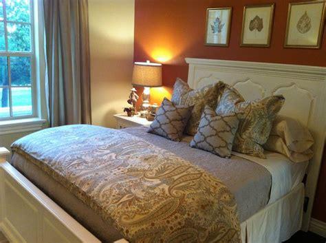 cream and orange bedroom autumn inspired guestroom designed by daniel berkeley