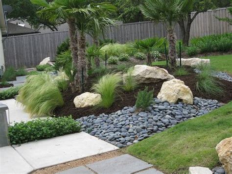 Boulder Landscaping Ideas Well Done Sculptural Placement Of M Feather Grass Pale Yellow Tone Rocks Blue River Rock And