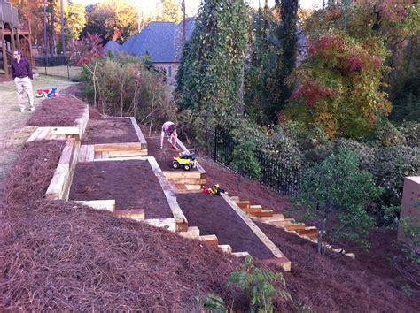 pretty awesome raised garden beds on a hillside