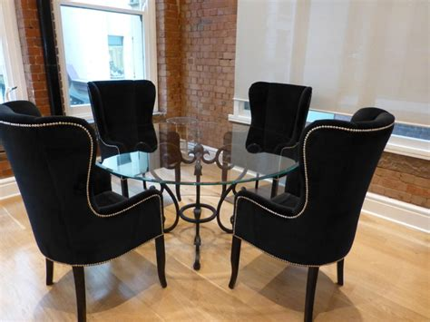 Dining Table And Upholstered Chairs Glass Top Iron Base Dining Table With Winged Studded Upholstered Chairs