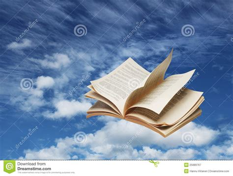 a sky of books open book flying on blue sky royalty free stock