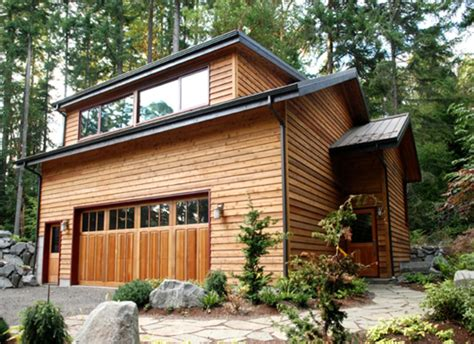 small house with garage garage with living space by coates design inc