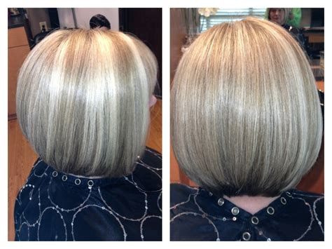 bob hair lowlights blonde angled bob with highlights and lowlights hair by