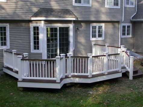 white railing with top railing and flooring same color and the house color is similar to ours
