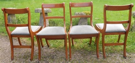 sold set of four regency style yew dining chairs