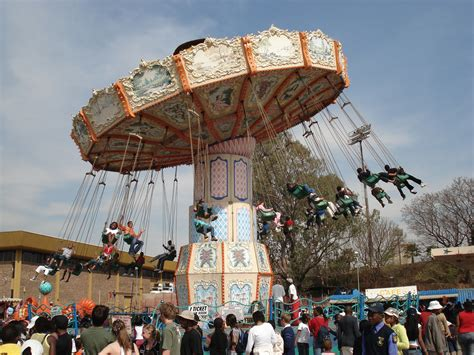 a swing ride at a carnival consists of chairs the swing ride