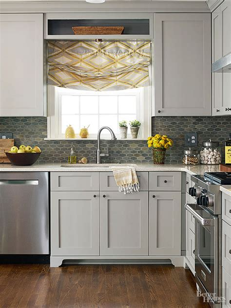 make a small kitchen look larger cabinet trim gray green and woodwork