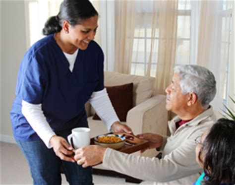 senior in home care assisting home care elderly