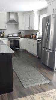 Laminate Flooring For Kitchens Hardwood Vs Laminate Wood Flooring What Should You Choose Small Room Decorating Ideas