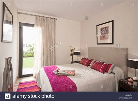 pink bedroom cushions pink throw and cushions on bed with upholstered grey