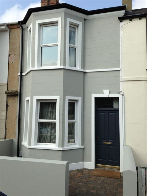 house exterior painted in hardwick white with front door in railings from modern country style