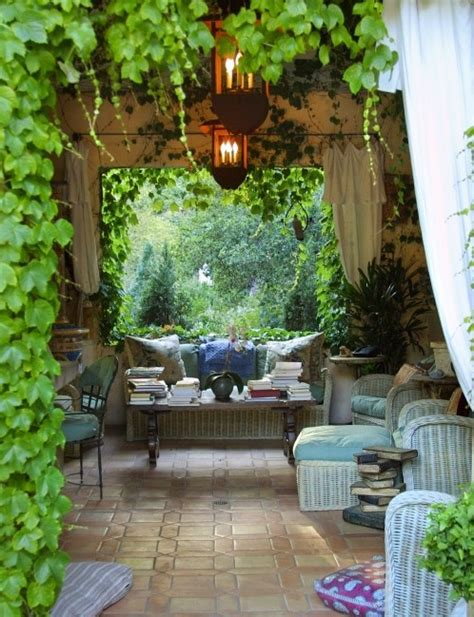backyard vines vines shade chandelier lighting and a comfy couch
