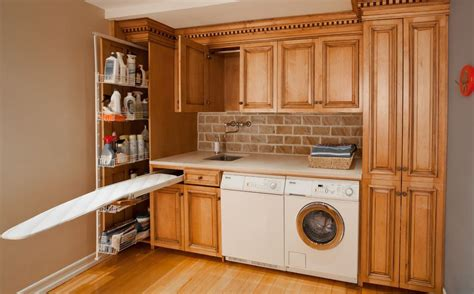 pull out ironing board cabinet ironing board cabinet extensions for organized laundry rooms