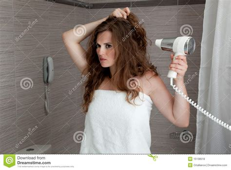 women using the bathroom attractive woman using fen in bathroom royalty free stock photos image 15138518