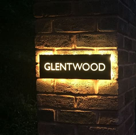 back lit house name in stainless steel