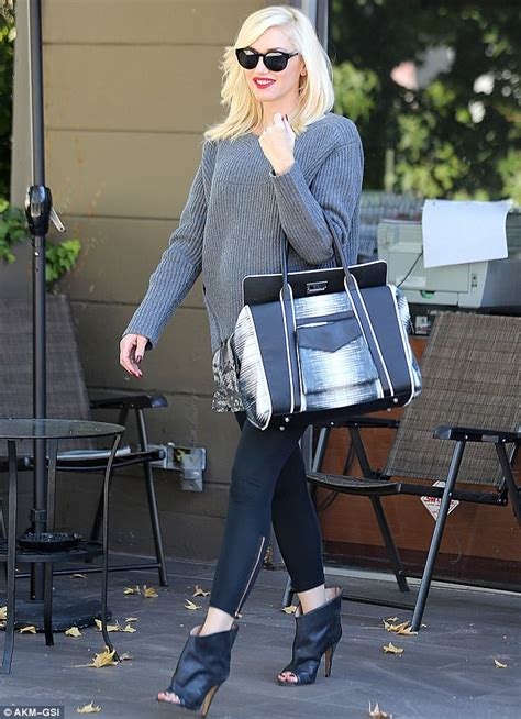 Other Designers Signature Handbag Gwen Stefani by Gwen Stefani Slithers Out Of Nail Salon In Snakeskin Tunic